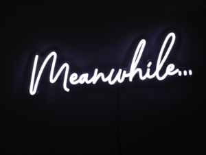 "black background with white, cursive script spelling out ""meanwhile..."""