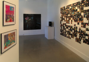 view of the gallery with 3 walls displaying student artwork